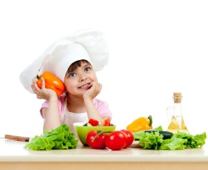 Chef girl preparing healthy food vegetable salad over white background